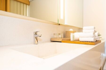 White sink and faucet water tap decoration in bathroom interior