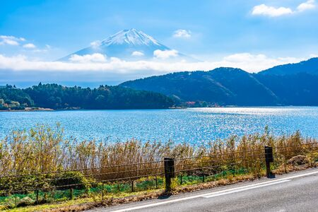 Beautiful landscape of mountain fuji with maple leaf tree around lake in autumn season Stock Photo