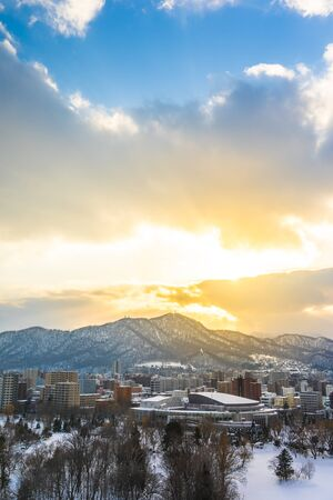 Beautiful architecture building with mountain landscape in winter season at sunset time Sapporo city Hokkaido Japan