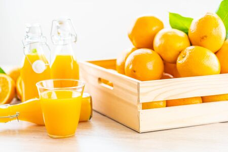 Fresh orange juice for drink in glass on wooden table - Healthy food concept 스톡 콘텐츠
