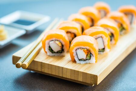 Salmon fish meat sushi roll maki on wood plate with wasabi and soy sauce - Japanese food style 스톡 콘텐츠