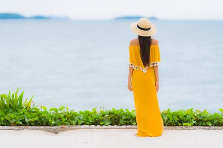 Portrait beautiful asian woman wear hat with smile happy leisure on the beach and sea ocean in holiday vacation 스톡 콘텐츠