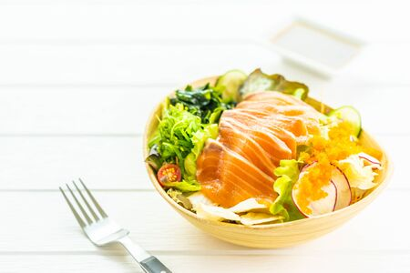 Raw fresh salmon fish meat sashimi with vegetables salad and sauce - Japanese and Healthy food concept 스톡 콘텐츠