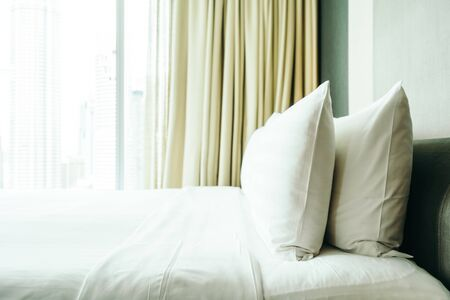 White comfortable pillow on bed decoration in  bedroom interior 스톡 콘텐츠