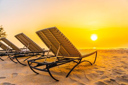 Empty chair on the tropical nature beach and ocean sea at sunrise or sunset time for leisure travel and vacation 스톡 콘텐츠