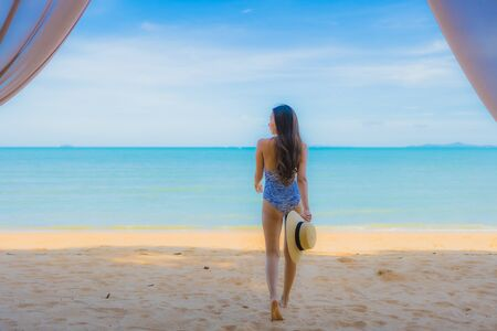 Portrait beautiful young asian woman happy smile relax on the tropical beach sea ocean for leisure travel in holiday vacation Reklamní fotografie - 132078477