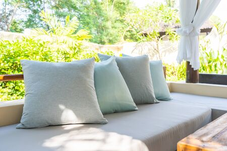 Pillow on sofa chair decoration outdoor patio with garden view for relax and leisure