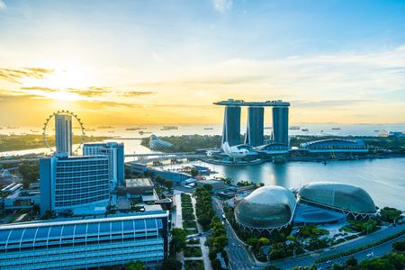 Beautiful architecture building exterior cityscape in Singapore city skyline at sunrise time Banco de Imagens - 124999334