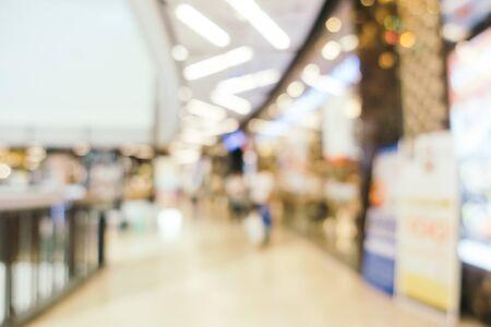 Sfuocatura astratta e centro commerciale defocused dell'interno del grande magazzino per fondo