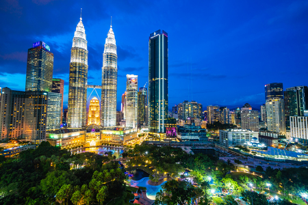 Beautiful architecture building exterior in Kuala Lumpur city in Malaysia for travel at twilight night Редакционное