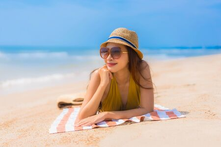 Portrait beautiful young asian woman smile happy and leisure on the beach and sea for vacation travel concept
