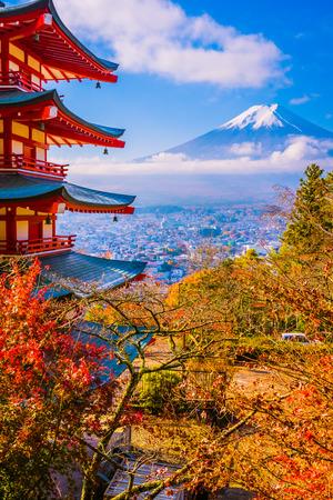 Beautiful landscape of mountain fuji with chureito pagoda around maple leaf tree in autumn season at Yamanashi Japan 新闻类图片