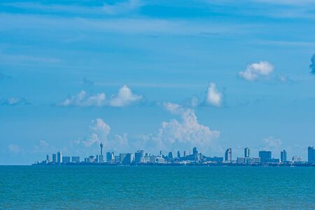 Beautiful landscape of sea with Pattaya cityscape and white cloud on blue sky background