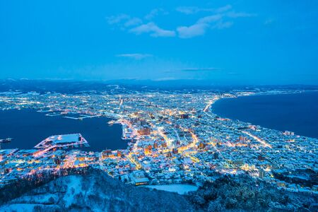 Beautiful landscape and cityscape from Mountain Hakodate for look around city skyline building and architecture at night Фото со стока