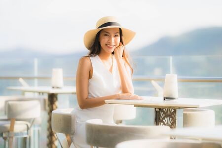 Portrait beautiful young asian woman smile happy in the sky bar and restaurant for relax and enjoy food
