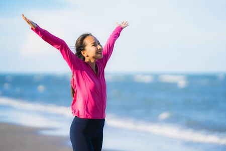 Portrait beautiful young asian woman running and exercising on the tropical outdoor nature beach sea ocean for healthy 写真素材