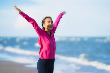 Portrait beautiful young asian woman running and exercising on the tropical outdoor nature beach sea ocean for healthy Zdjęcie Seryjne