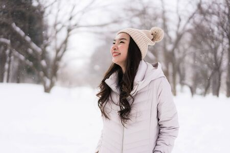 Beautiful young asian woman smiling happy with travel in snow winter season at Hokkaido Japan Stock fotó