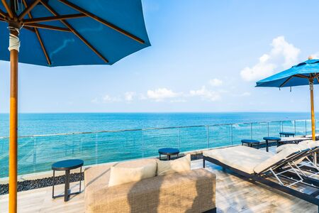 Umbrella and chair with panorama of sea and ocean view for vacation and travel 免版税图像