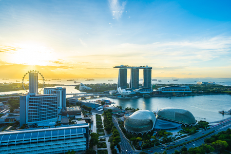 Beautiful architecture building exterior cityscape in Singapore city skyline at sunrise time