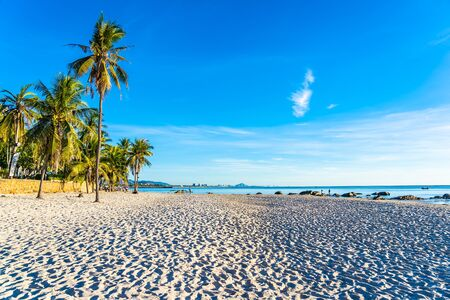 Beautiful outdoor landscape of sea ocean and beach with coconut palm tree in hua hin Thailand Archivio Fotografico - 128376076