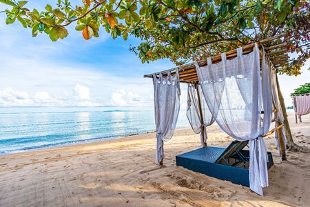 Empty bed chair and lounge on the tropical beach sea ocean with white cloud on blue sky for leisure travel and in holiday vacation Stock Photo