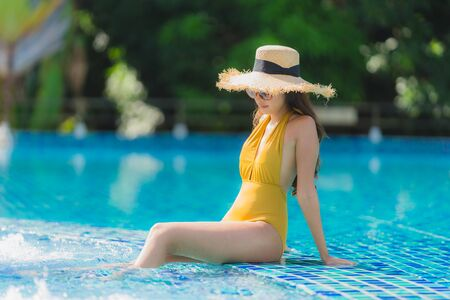 Portrait beautiful young asian woman leisure relax smile and happy around swimming pool in hotel resort for holiday vacation trip 写真素材