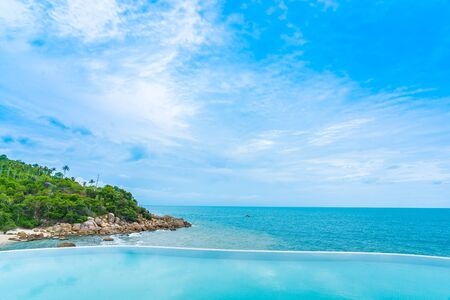 Beautiful outdoor infinity swimming pool  with sea ocean view and white cloud blue sky for holiday vacation and travel