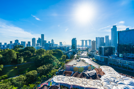 Beautiful architecture building exterior cityscape in Singapore city skyline with white cloud on blue sky
