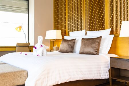 Beautiful elephant towel on bed with pillow and blanket decoration in bedroom interior