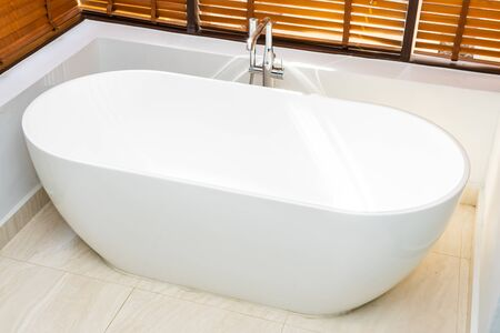 Beautiful luxury and comfortable white bathtub decoration in bathroom interior for spa relax Banco de Imagens