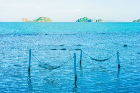 Empty hammock around beautiful beach sea ocean for relax in holiday vacation travel concept Stock Photo