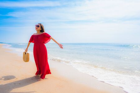 Portrait beautiful young asian woman smile with happy and walk on the beach and sea for leisure holiday vacation concept Zdjęcie Seryjne