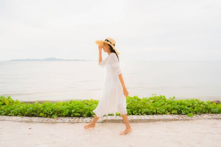 Portrait beautiful asian woman wear hat with smile happy leisure on the beach and sea ocean in holiday vacation 版權商用圖片