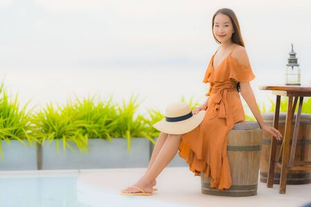 Portrait beautiful young asian woman lifestyle happy smile with leisure nearly sea beach ocean in holiday vacation