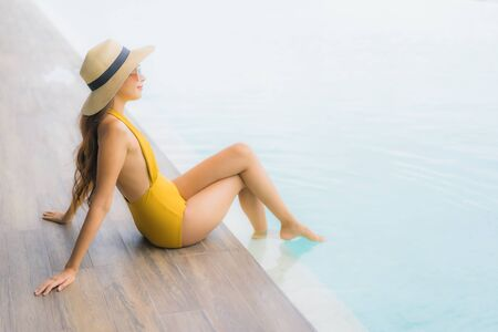 Portrait asian beautiful young woman happy smile relax around outdoor swimming pool in holiday vacation travel trip