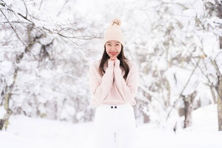 Portrait Young Beautiful asian woman smile happy travel and enjoy with snow winter season in Hokkaido Sapporo Japan Zdjęcie Seryjne