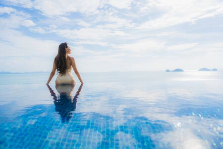Portrait young asian woman relax smile happy around swimming pool in hotel and resort for holiday vacation travel concept Zdjęcie Seryjne