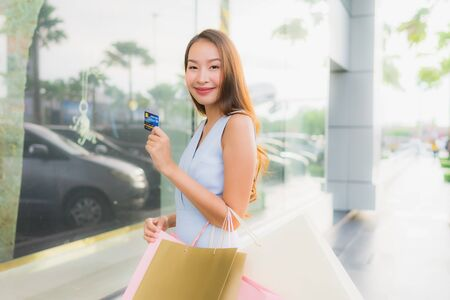 Portrait beautiful young asian woman happy and smile with shopping bag from department store mall