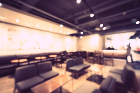Abstract blur and defocused restaurant and coffee shop cafe interior for background