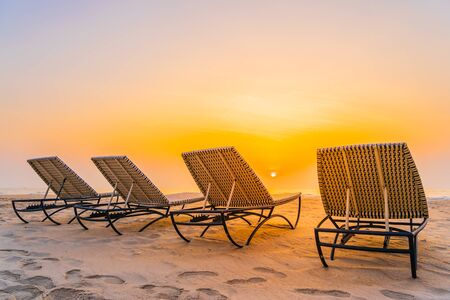 Empty chair on the tropical nature beach and ocean sea at sunrise or sunset time for leisure travel and vacation Фото со стока