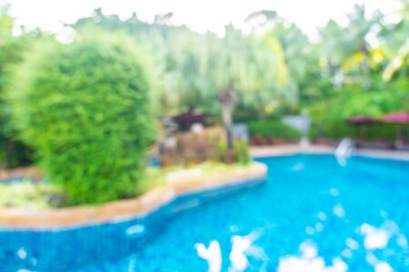 Abstract blur and defocus beautiful outdoor swimming pool in hotel resort for leisure relax in vacation