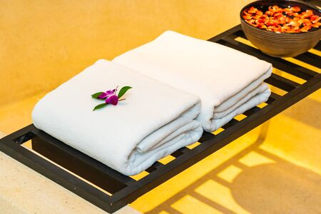 Clean and White towel with flower for relax in spa