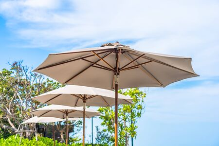 Umbrella and chair on the beach sea ocean with blue sky and white cloud for leisure travel and vacation