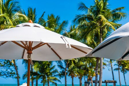 Beautiful landscape of sea ocean on sky with umbrella and chair around luxury outdoor swimming pool in hotel resort for leisure travel and vacation