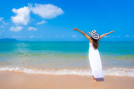 Portrait beautiful young asian woman happy smile leisure on the beach sea and ocean with blue sky white cloud for vacation travel