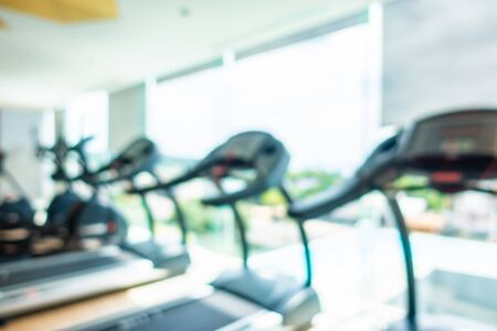 Abstract blur and defocus fitness equipment in gym room interior for background 写真素材
