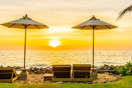 Beautiful Landscape of sea ocean on sky with umbrella and chair around there at sunset or sunrise time for leisure vacation travel concept Фото со стока
