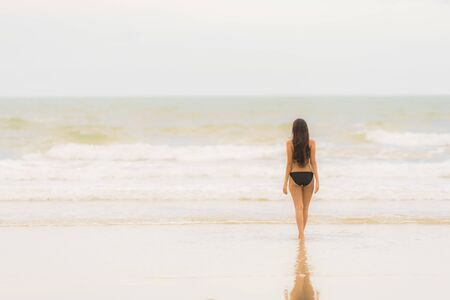 Portrait beautiful young asian woman wear bikini on the beach sea ocean for leisure relax in holiday vacatiom time