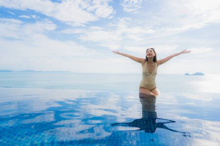 Portrait young asian woman relax smile happy around swimming pool in hotel and resort for holiday vacation travel concept Zdjęcie Seryjne - 130031853